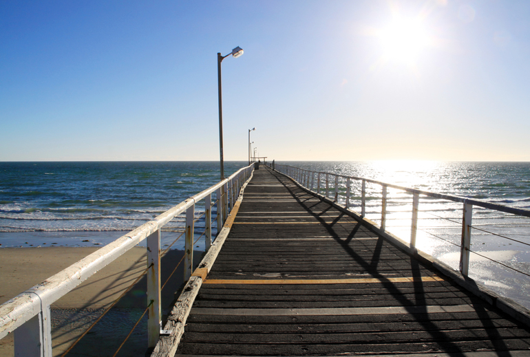 Long Wooden Jetty in Strong Sunlight. Largs Bay Jetty, Adelaide